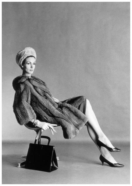 Jennifer Hocking in three-quarter grey Australian possum coat from Calman Links, black calf bag by Bagcraft, photo by Vernier, Vogue UK, August 1961