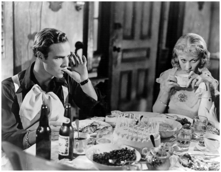 Marlon Brando and Vivien Leigh celebrate a tense birthday as Stanley Kowalski and Blanche DuBois in A Streetcar Named Desire, 1951