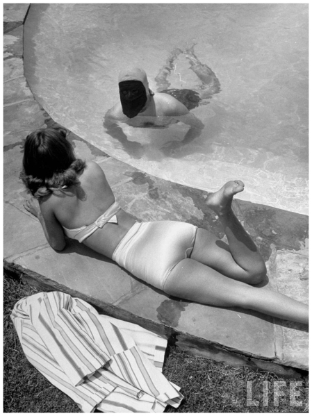 Radio personality Jack Rourke (The Masked Spooner) flirting with lady at poolside Loomis Dean 1948 LA