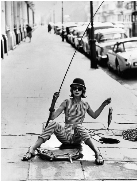 Ros Watkins in grey and white striped denim jeans and cropped top by In Fashion, photo by Vernier, London, Vogue, July 1961