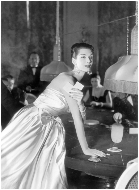 Simone d'Aillencourt in pearly satin with its own stole lined in the lilac reverse-side of the satin by Susan Small, photo by Vernier, Vogue UK, July 1957
