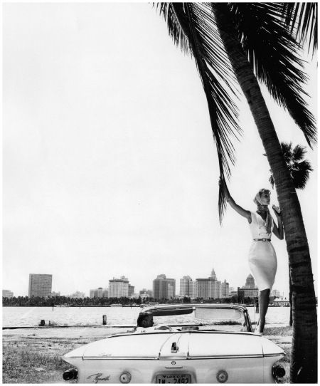 Tania Mallet in white sleeveless shantung dress by California Casuals, photo by Vernier in Miami, Florida, Vogue UK, January 1961
