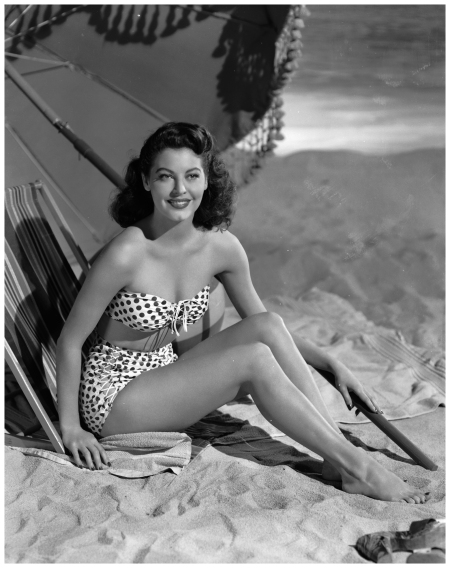 Actress Ava Gardner lounges on the beach in a spotted bikini, 1944