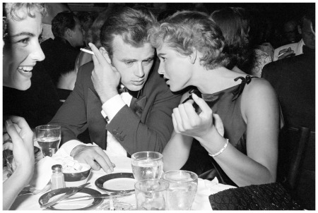 James Dean Seated at Dinner with Ursula Andress 1955 Hollywood notables during a charitable affair at Ciro's, a famous Hollywood nightclub Corbis Archive