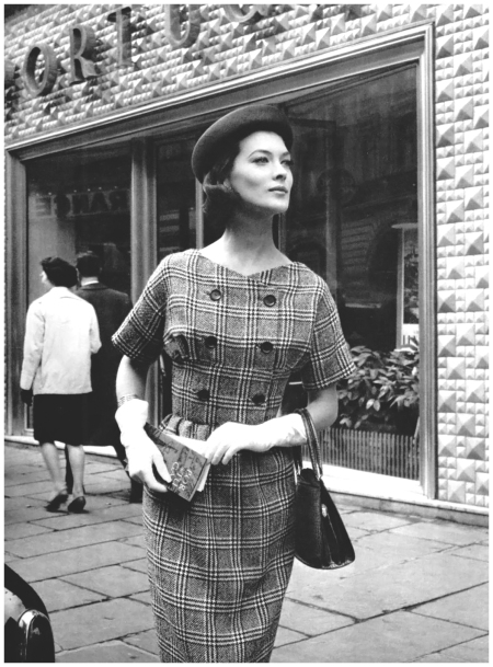 Rose Marie in Prince of Wales check wool dress with double-breasted bodice by Revillon, hat by Gilbert Orcel, photo by Pottier outside Casa de Portugal, Paris, 1959