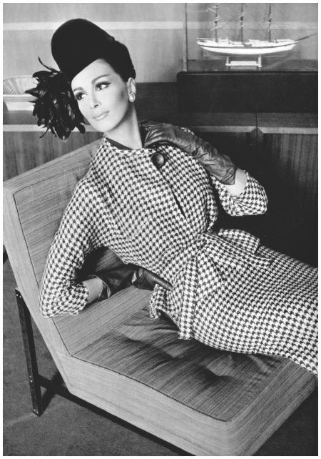 Wilhelmina in wool cassis (dark purple) and white houndstooth two-piece with same fabric belt, single button closure, by Pierre Cardin, photo by Pottier, 1962