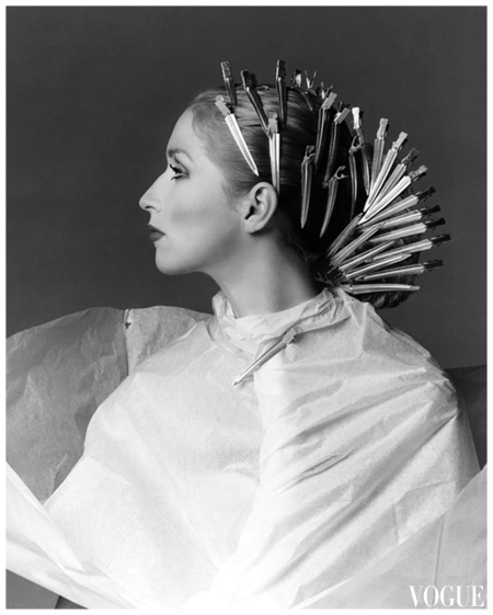Chris Royer wearing long %22straightening%22 clamps in preparation for a new hairstyle by Dina Azzolini of Milan, photo by Francesco Scavullo, March 1975
