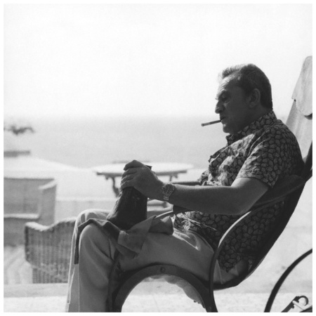 Luchino Visconti Ischia holding an art nouveau vase, by Hugo Leven, at his family villa La Colombaia 1970