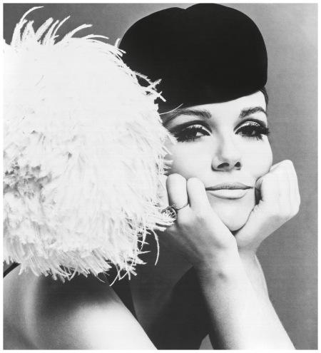 Nicole de la Marge in a Peter Shepherd velvet cap with large ostrich feather pom-pom, 1965