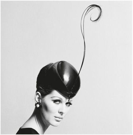 Nicole de la Marge wearing a pillbox hat with feather, 1960s