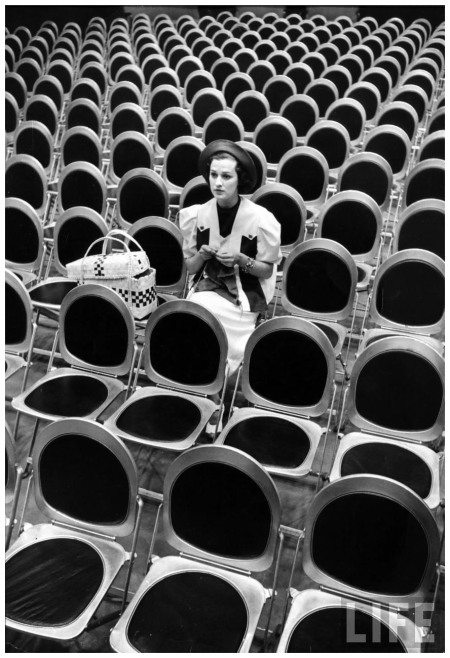 Popular singer Jane Froman knitting while sitting in empty studio audience chairs during a radio broadcast rehearsal 1936 Photo Alfred Eisenstaed