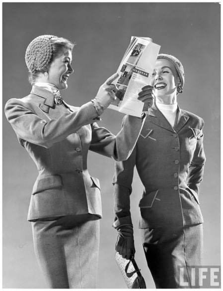 Two models wearing suits w. fitted jackets & narrow skirts, crocheted head-hugging hats. Circa 1946 Photo Gjon Mili