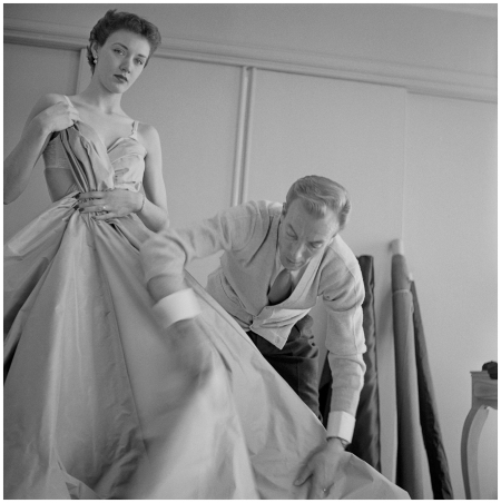 Jacques Fath Arranging Model's Dress