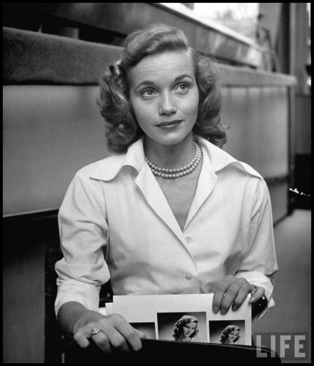 Actress Eva Maria Saint, taking her portraits and calling cards from her briefcase Nina Leen 1949