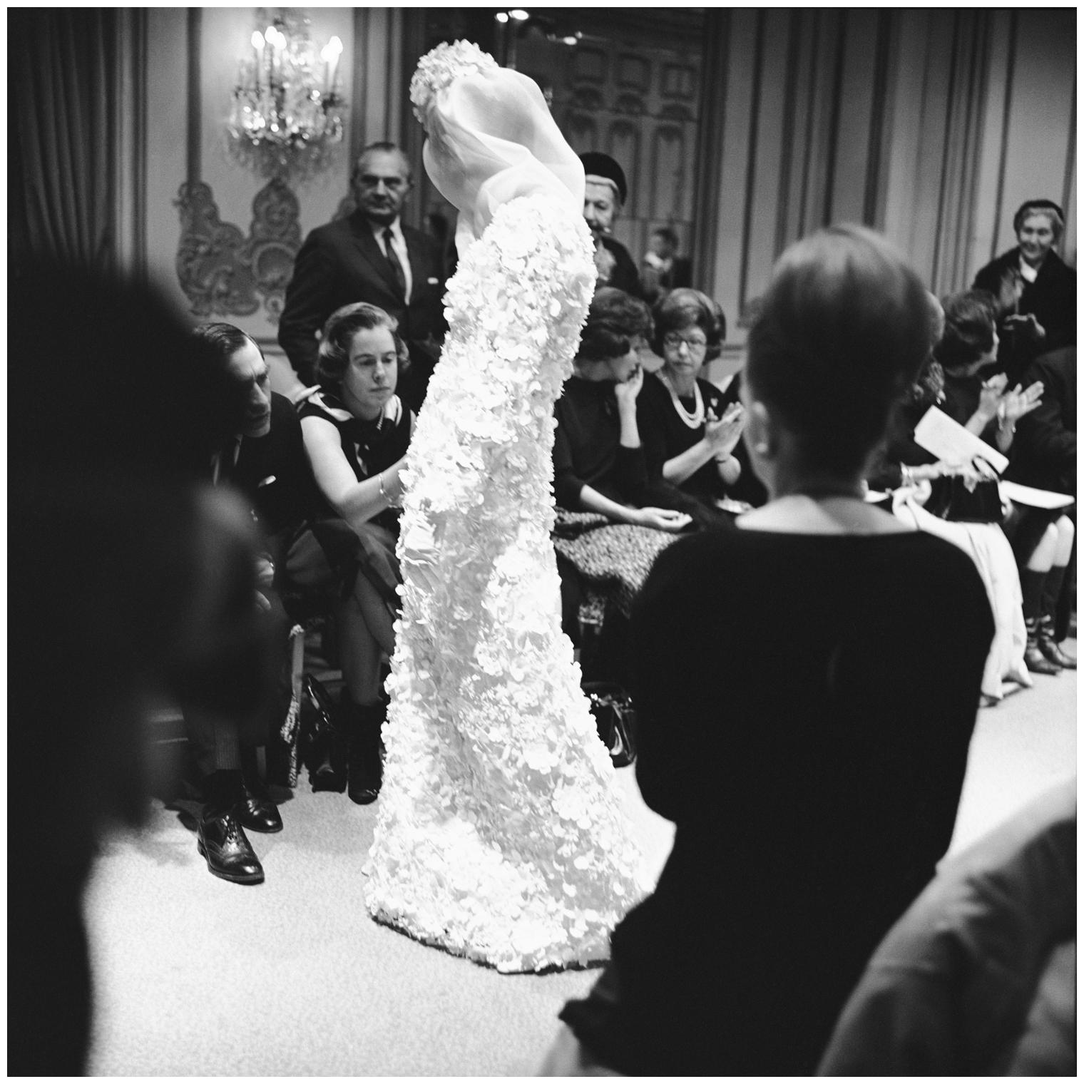 Buyers examine a gown from James Galanos\'s 1964   © Pleasurephoto Room