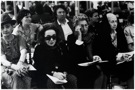Critics and buyers examine a 1977 Dior collection. Photograph by Eve Arnold:Magnum