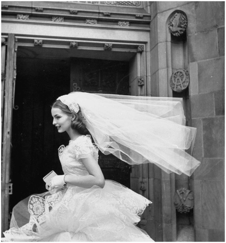 Model Martha Boss, the country's top bridal model is wearing a nylon tulle lace gown and veil.  (Photo by Leonard Mccombe::Time Life Pictures:Getty Images) 1952