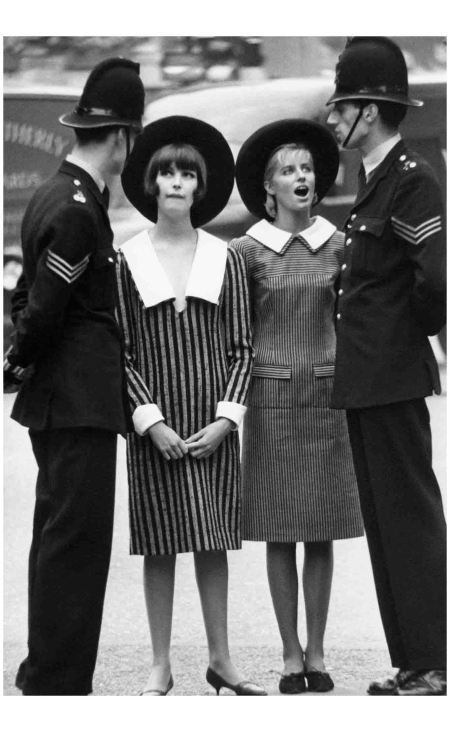 Models Talking to Policemen