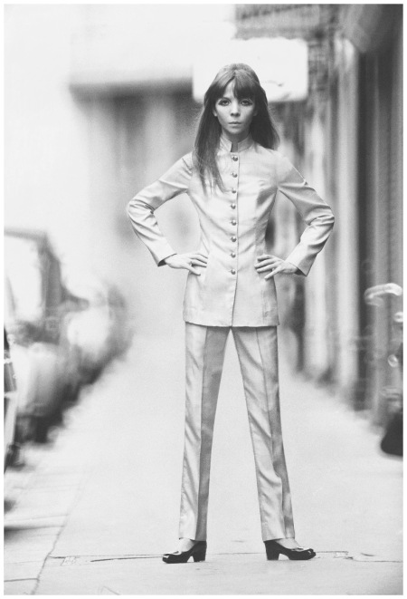 Penelope Tree wearing Chairman Mao-influenced suit made of shantung silk, brass buttons down front; on a Paris street Photo Baron Arnaud De Rosnay
