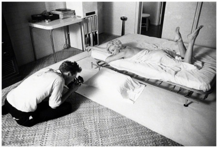 Photographer Douglas Kirkland shoots movie star Marilyn Monroe wrapped in a white sheet on a bed Douglas Kirkland:Corbis LA 1961