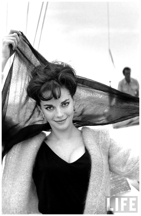 Portrait of actress Natalie Wood aboard boat, holding scarf behind her head 1962 Paul Schutzer