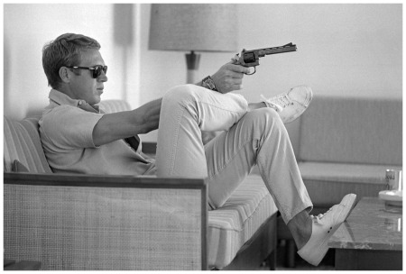 Steve McQueen  Photo John Dominis - Time & Life Pictures_Getty Images_At his bungalow in Palm Springs, Steve McQueen practices his aim before heading out for a shooting session in the desert, 1963