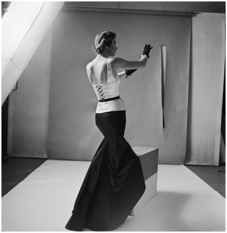 A model wears a fomal satin gown designed by Mainbocher with matching black gloves 1949 Photo Genevieve Naylor