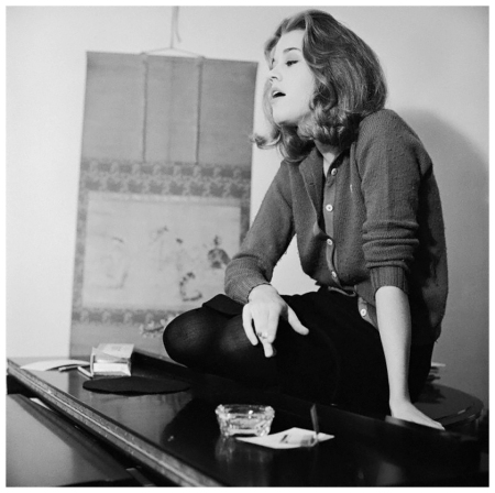 Actress Jane Fonda Smoking on Top of a Piano Photo Genevieve Naylor 1962