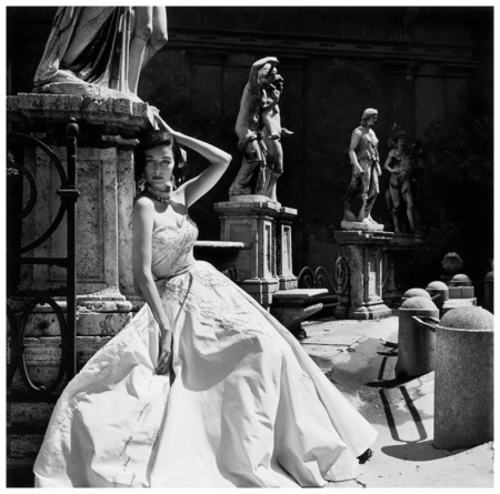 Dorian Leigh models an evening dress for Giovannelli-Sciarra. Italy 1952