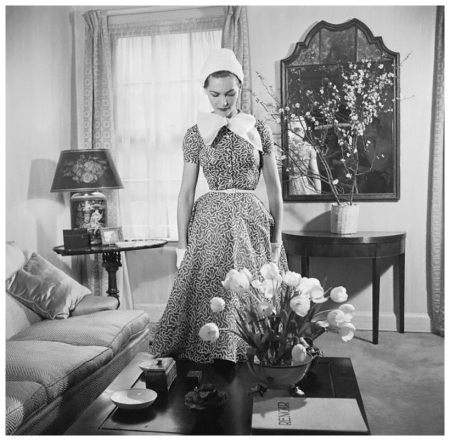 Georgia Hamilton models a slate gray and white day dress by Carolyn Modes 1951 Photo Genevieve Naylor a