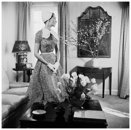 Georgia Hamilton models a slate gray and white day dress by Carolyn Modes 1951 Photo Genevieve Naylor