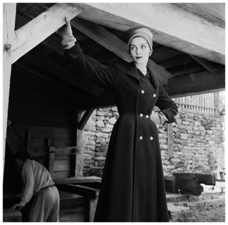 Georgia Hamilton models a wool coat suit by Seymore Fox in the barn at Philipes Manor Hall 1952 Photo Genevieve Naylor