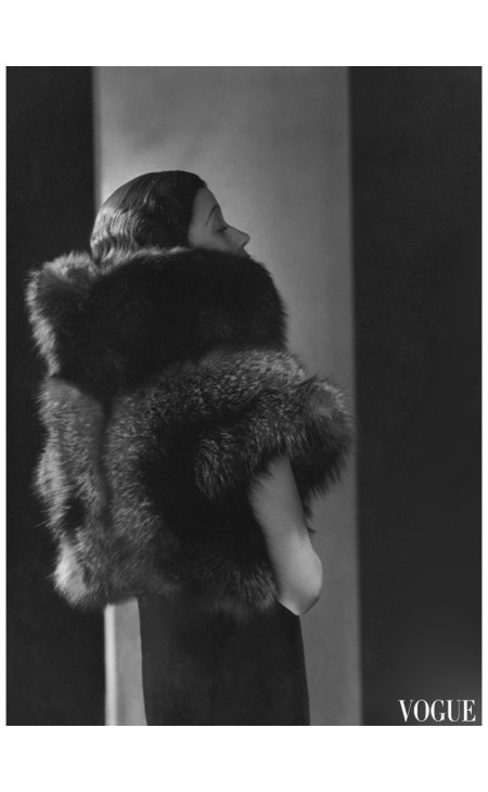 Toto Koopman, 1933 George Hoyningen-Huen wearing short sleeveless fur evening jacket by Heim 1933 Vogue