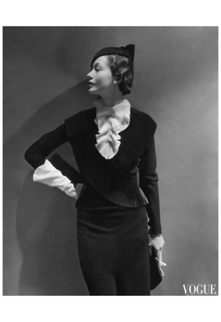 Toto Koopman, 1934 George Hoyningen-Huene Mlle. Koopman wearing black wool dress with pleated jabot and black felt hat, both by Mainbocher, and antelope handbag by Germaine Guerin