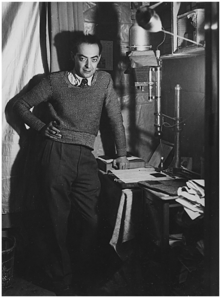 BRASSAÏ (GYULA HALÁSZ) Self-Portrait Standing in Dark Room, 1932