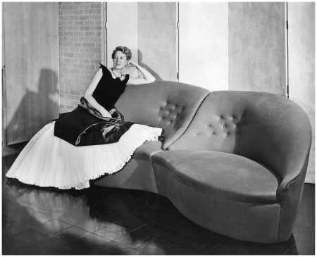 Dominique de Menil at home, in Charles James and on Charles James couch, circa 1951