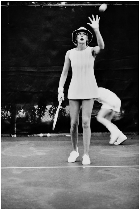 Model wearing a white tennis dress by Court I, with tennis hat by Madcap, January 1972