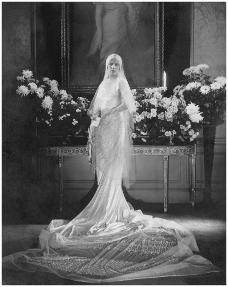 Mrs. Charles Coudert Nast, 1929  Mrs. Charles Coudert Nast (nee Charlotte Babcock Brown) (Conde Nast's daughter-in-law) wearing wedding dress with very long train and tulle veil swirled on floor before her Condé Nast Archive