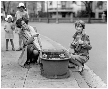 April 21, 1927. %22Do ducks swim? Misses Eugenia Dunbar and Mary Moose.%22 The main focus here is of course the horse trough, once a common item of street furniture in many big cities. National Photo glass negative