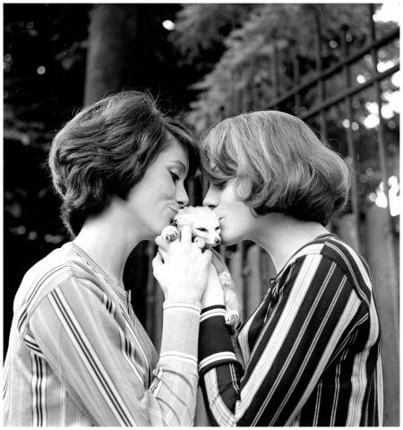 Catherine Deneuve And Françoise Dorléac The sisters, in their matching stripes, smothered a feline with kisses in an outdoor portrait series from 1960 Globe photo