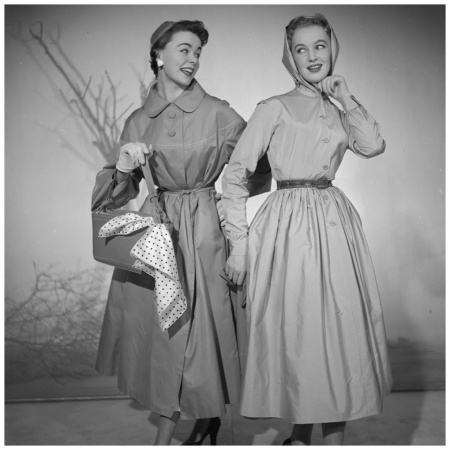 Day Out - Two women modelling raincoats and hats. (Photo by Chaloner Woods:Getty Images) 1953