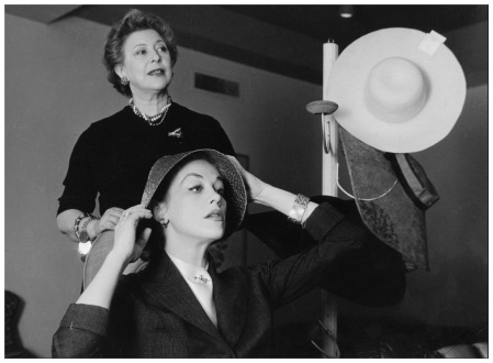 Hildegard Knef and New York hat designer Lilly Daché trying to find the right hat for the Easter Parade. (AP Photo)