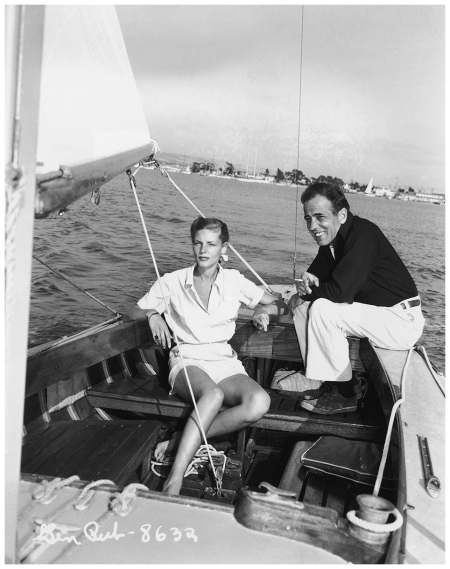 Humphrey Bogart  1899-1957 and Lauren Bacall aboard the Santana, a 55-foot, 16-ton yawl. The Bogarts kept the Santana at Newport Beach. Next to Lauren Bacall, the Santana was the great love of Bogey's life. Photo was taken 1947:8