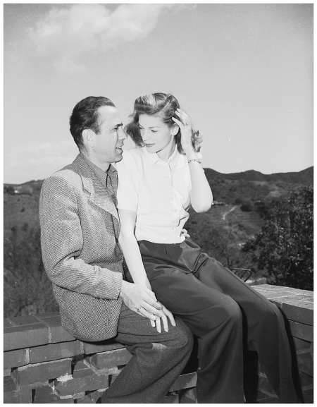 Humphrey Bogart (1899 - 1957) with his wife, Lauren Bacall, his co-star in 'To Have and Have Not' and 'The Big Sleep'. (Photo via John Kobal Foundation:Getty Images) 1945