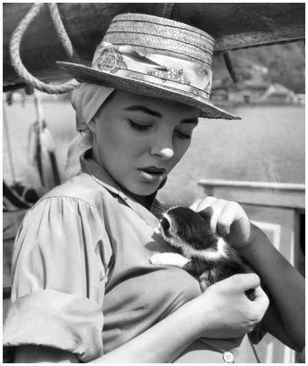 Joan Collins In 1957, British-born actress Joan Collins lounged on a boat that came with its own kitten Getty