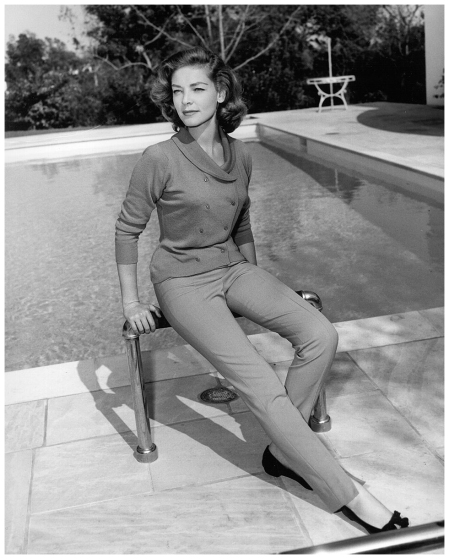Lauren Bacall wears an Italian sweater for sportswear as she poses for a portrait in the backyard of her home after completing work in the film 'The Cobwebs' on April 22, 1955 in Bel Air, California. (Photo by Michael Ochs Archives:Getty Images)