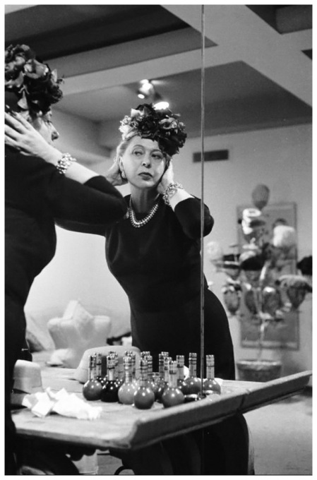 Lilly Daché checks out a design, circa 1956. Today her hats and dresses are highly sought after by vintage collectors. (Photo Leonard McCombe:Time & Life Pictures