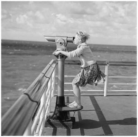 Scheveningen 1961 girl looking in binoculars on the pier of Scheveningen Photo henk Jonker