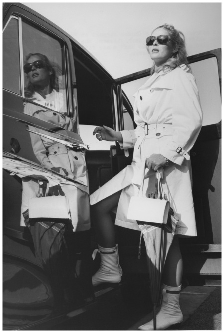 Ursula Andress wearing sunglasses, a white raincoat and boots, as she prepares to enter a car upon her arrival at London Airport 1965 ndress had arrived for wardrobe fittings for the film 'The Blue Max' Getty Archive