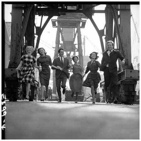 A group of models in autumn:winter outfits at a dockyard, 12th September 1960 Photo Brian Duffy